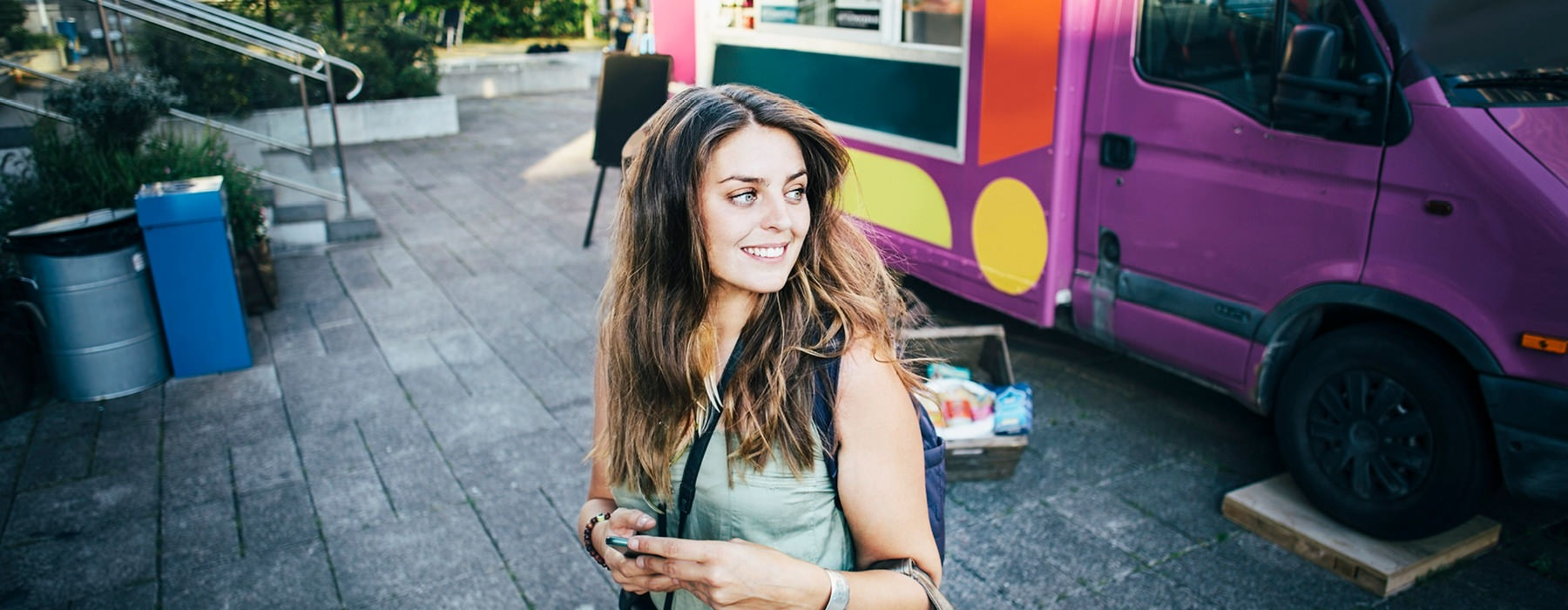 Woman on phone by foodtruck