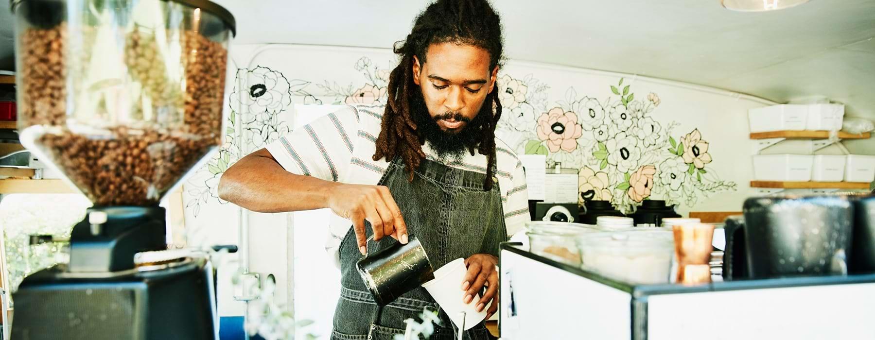 Man making coffee at coffee shop